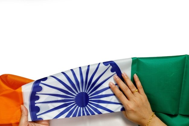 Top view of human hands holding a national flag of india on white background. Premium Photo