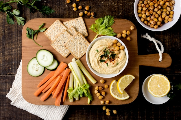 Top view of hummus with assortment of vegetables Free Photo