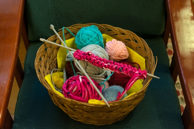 A top view image of crochet yarn and hook on a sofa. Premium Photo
