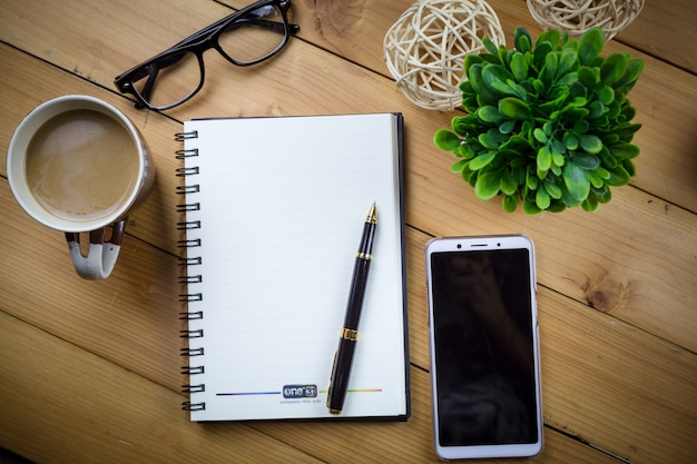 Top view image of open notebook on wooden table. Premium Photo