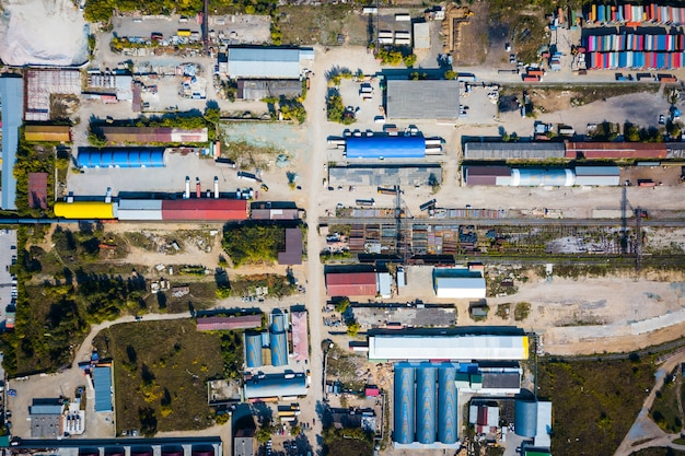 Top view of the industrial zone: garages, warehouses, containers for storing goods. Premium Photo