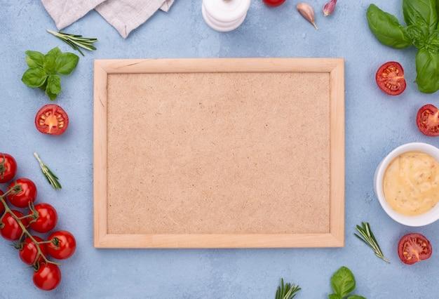 Vista dall'alto ingredienti e cornice Foto Gratuite