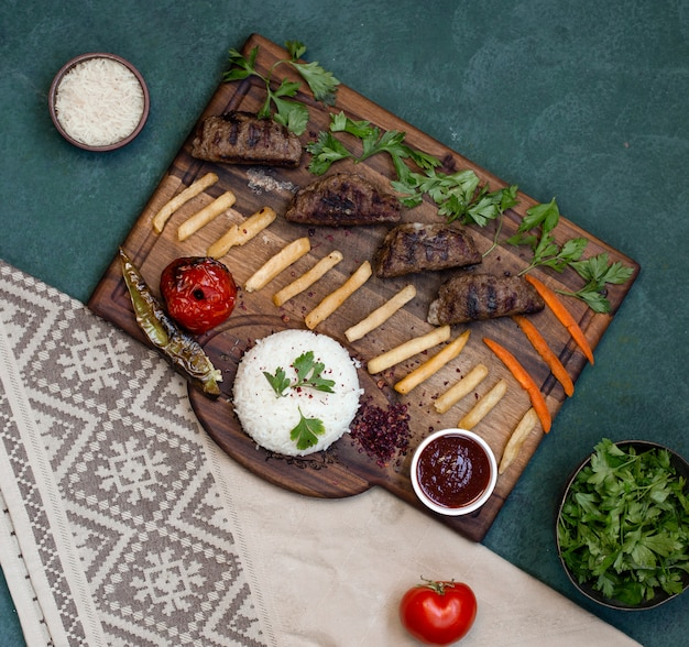Top view kebab board with grilled foods. Free Photo