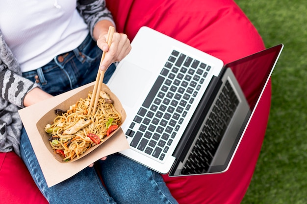 Top view laptop and fast food in the park Free Photo
