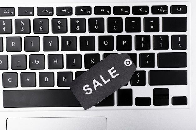 Top view laptop keyboard with sale tag Free Photo