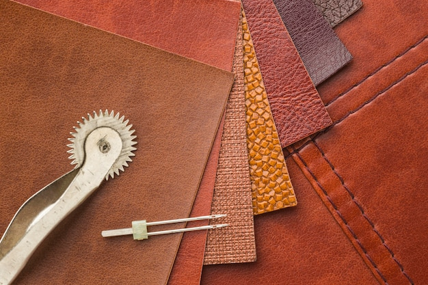 Top view of leather with needle Free Photo