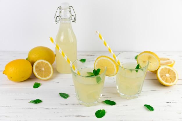Top view lemonade glasses arrangement Free Photo