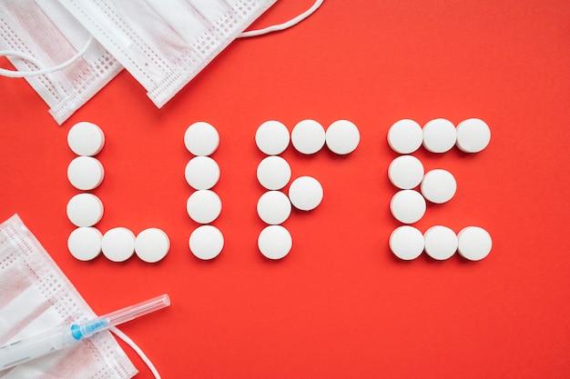 Top view of  life word over red background. top view. stop coronavirus Premium Photo