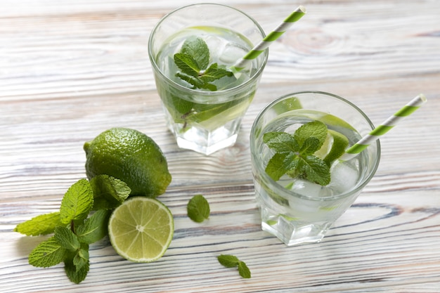 Top view lime lemonade glasses on table Free Photo