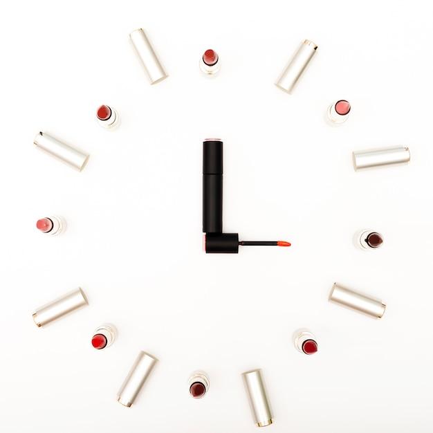 Top view lipsticks simulating clock Free Photo
