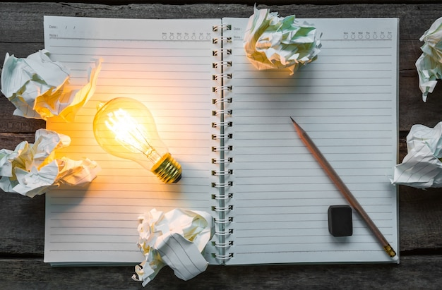 Top view of lit light bulb on a notebook Free Photo