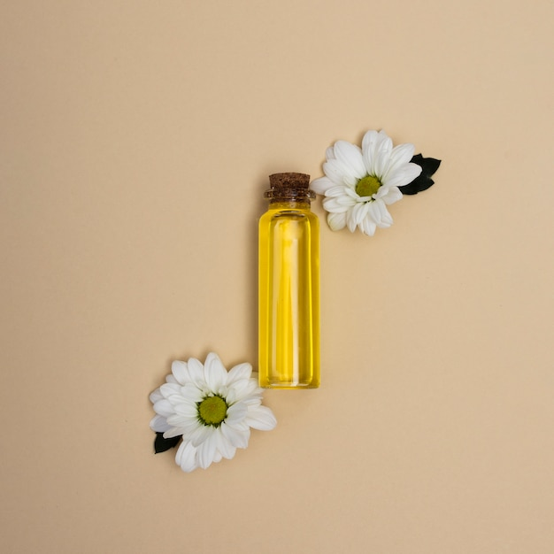 Top view little bottle of oil with flowers Free Photo