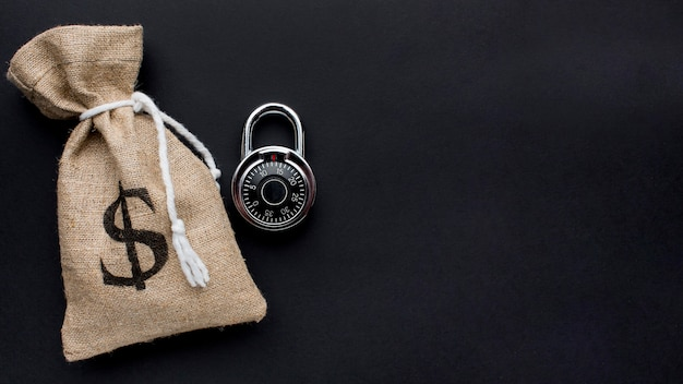 Top view of lock with money bag and copy space Free Photo