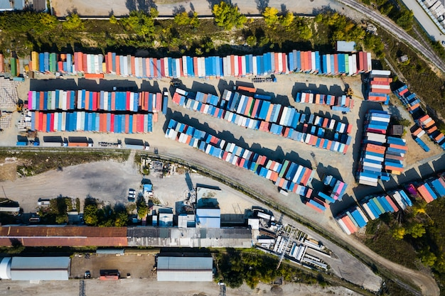 Top view of logistics center, a large number of containers of different colors for storing goods. Premium Photo