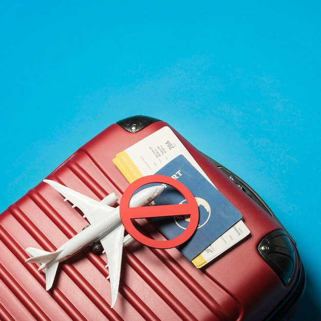 Top view luggage on blue background Free Photo