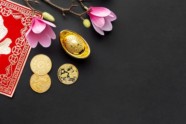 Top view of magnolia and golden coins chinese new year Free Photo