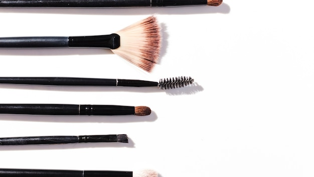Top view make up brushes on white background Free Photo