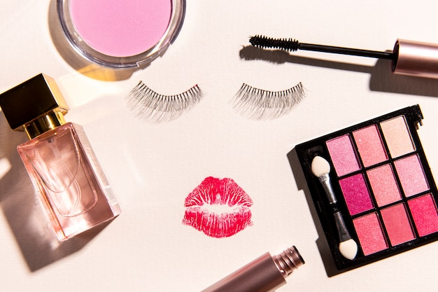 Top view of make up cosmetics on plain background Free Photo
