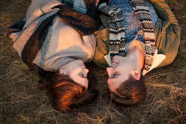 Top view man and woman laying on the grass Free Photo