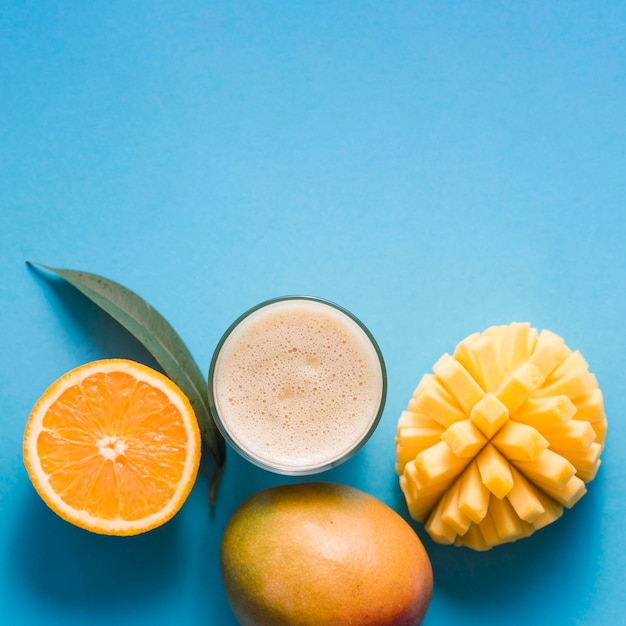 Top view mango and orange smoothie with copy-space Free Photo