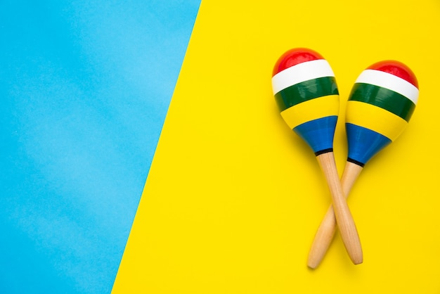Top view for maracas beautiful color on a colorful background. Premium Photo