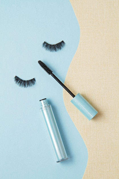 Top view of mascara brush over the blue background Premium Photo