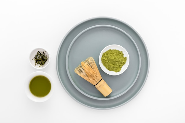 Top view matcha powder with bamboo whisk Free Photo