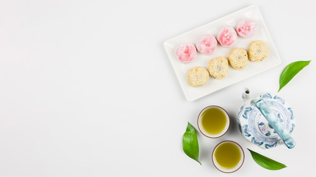 Top view of matcha tea and mochis Free Photo