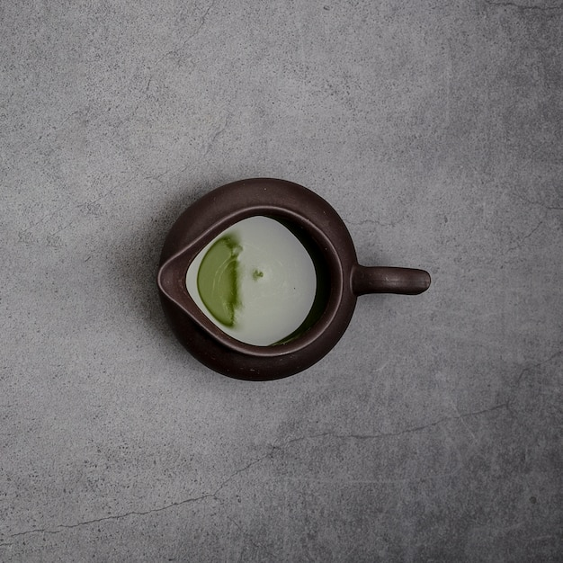 Top view of matcha tea in pourer Free Photo