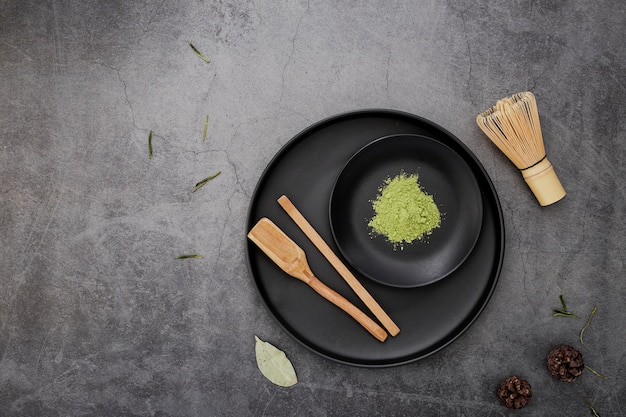 Top view of matcha tea powder with bamboo whisk Free Photo