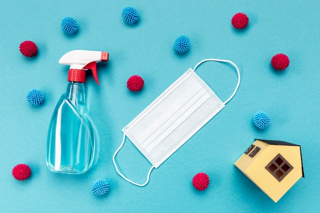 Top view medical mask with cleaning solution Free Photo