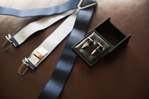 Top view of men's accessories on dark Premium Photo