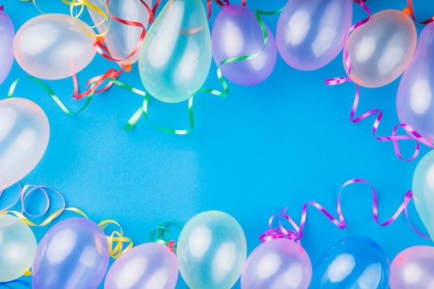 Top view metallic transparent balloons Free Photo