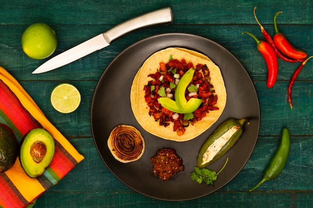 Top view mexican dish with wooden background Free Photo