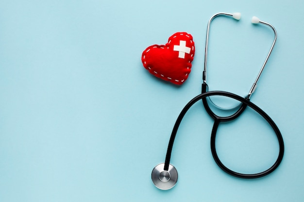 Top view minimalist red heart with stethoscope Premium Photo