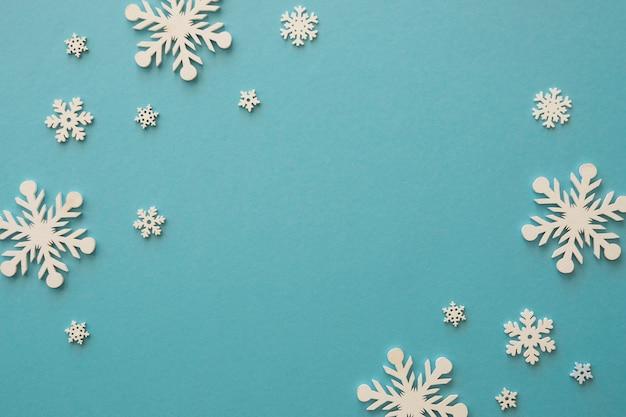 Top view minimalist white snowflakes Free Photo