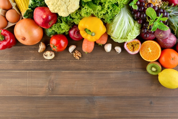 Top view of mixed  colorful healthy raw food wood kitchen countertop background Premium Photo