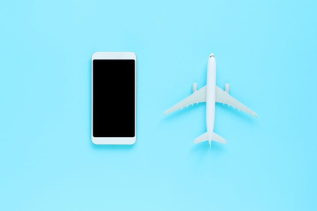 Top view of mobile and plane on blue isolated background with copy space Premium Photo