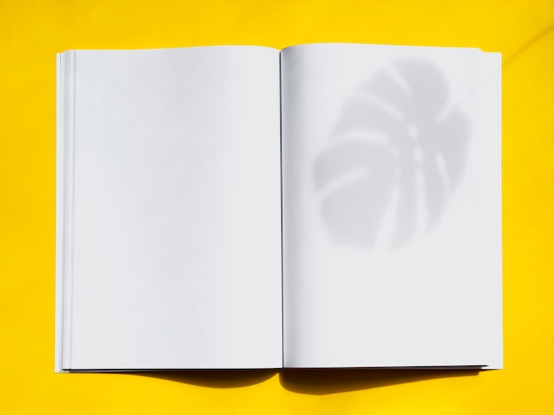 Top view mock-up magazine with yellow background Free Photo