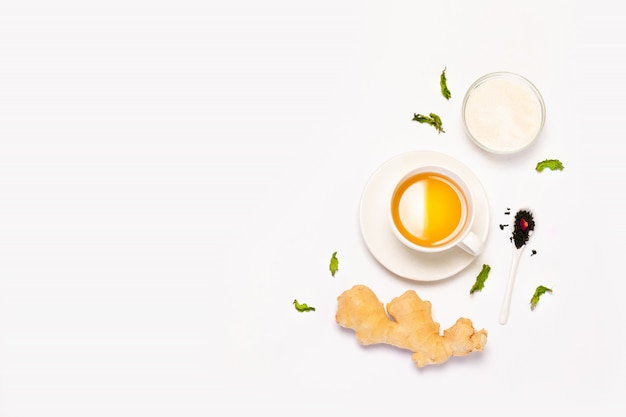 Top view mockup of cup of herbal tea, fresh ginger, mint and sugar Premium Photo