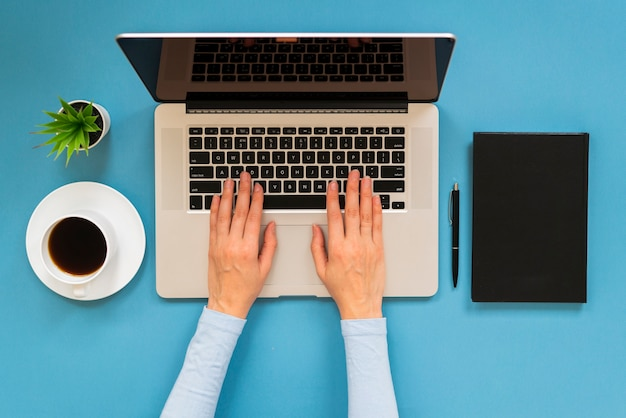 Top view of modern woman typing Free Photo