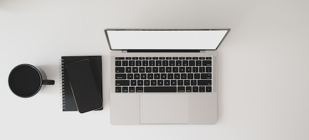 Top view of modern workspace with laptop computer, notebook and coffee cup Premium Photo