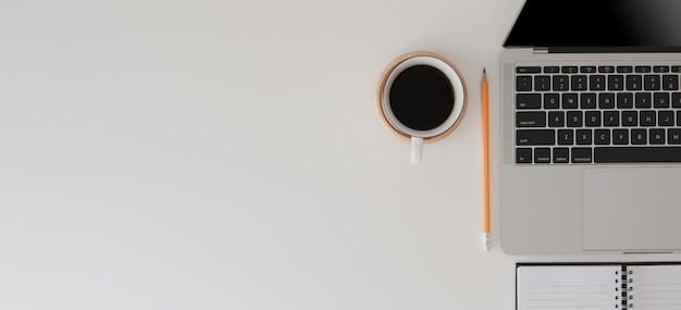 Top view of modern workspace with laptop computer, office supplies and coffee cup Premium Photo