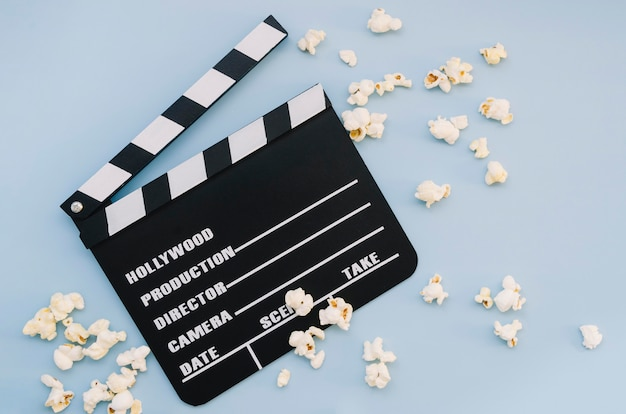 Top view movie clapperboard with popcorn Free Photo