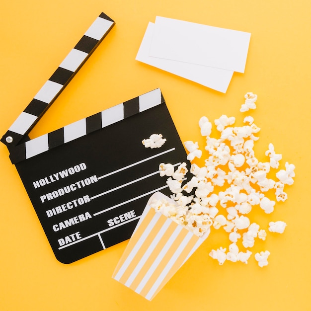 Top view movie clapperboard with tasty popcorn Free Photo