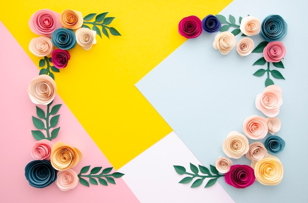 Top view multicolored background with flowers frame Free Photo