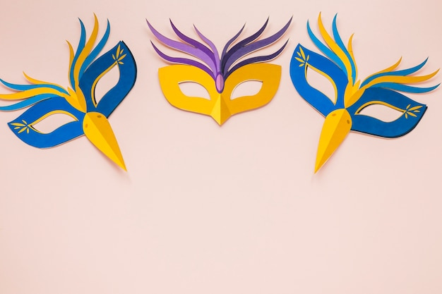 Top view of multicolored masks for carnival Free Photo