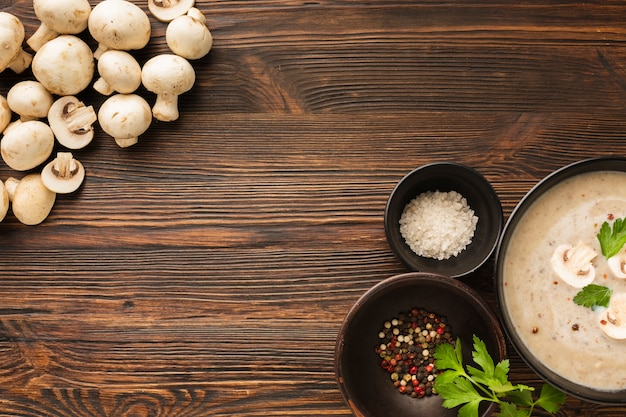 Top view mushrooms bisque and condiments with copy space Free Photo