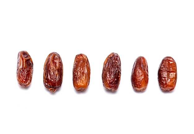 Top view of natural sweet dates isolated on white Premium Photo
