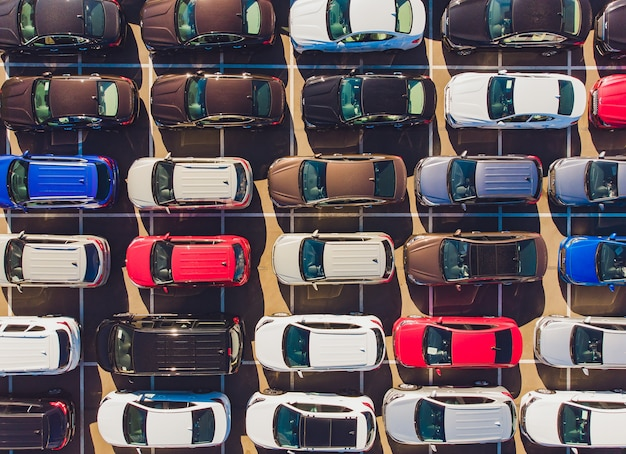 Top view of new cars lined up outside an automobile factory for import export. Premium Photo